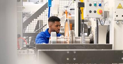 Operator working in tissue converting production plant